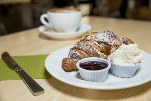 Croissant with jam and cream