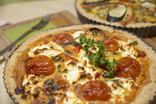 Freshly baked quiche with tomato
